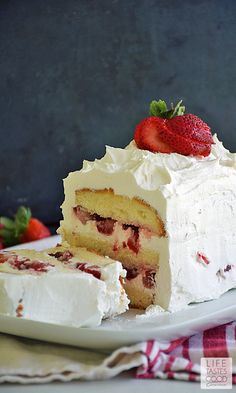 No Bake Strawberry Cake | by Life Tastes Good is perfect for summer, y'all. It is bursting with fresh, sweet strawberries sandwiched between layers of buttery cake, and all topped off with the sweet creamy goodness of whipped topping. Doesn't that sound amazing? But wait it gets better...