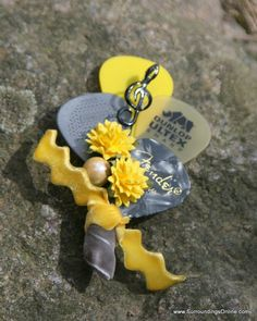 Making these! Yellow and Gray Guitar Pick Boutonniere by SurroundingsOnline, $23.95