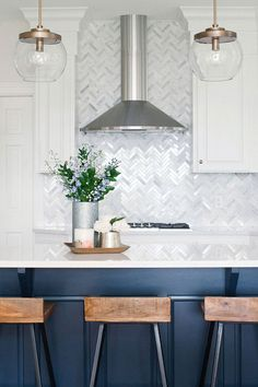 Transitional Kitchen With Navy Island White Traditional Cabinets And Gray Marble Herringbone Backsplash Tile White Kitchen Backsplash, Kitchen Redo, Home Decor Kitchen, Kitchen Interior, Home Kitchens, New Kitchen, Kitchen Remodel, Backsplash Marble, Backsplash Ideas