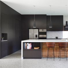 If your kitchen is flooded with light, then dark walls are just what you need to elevate its design. This image from #ReidHouse…