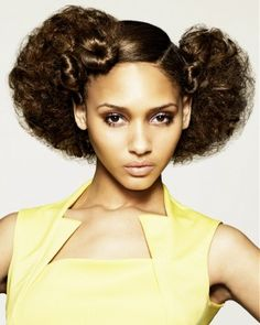 A long brown curly hold hairstyle by Ishoka