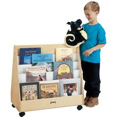 Find out more about the Jonti-Craft®Double Sided Pick-a-Book Stand - Mobile today! Our popular twin-sided Pick-a-Book Stand now on casters. Back is identical to front with equal storage capacity. Eight shelves total, approximately 1 Book Racks, Book Stands, Paper Storage, Early Learning, Quality Furniture, Storage Chest, Craft, Twin, Art School