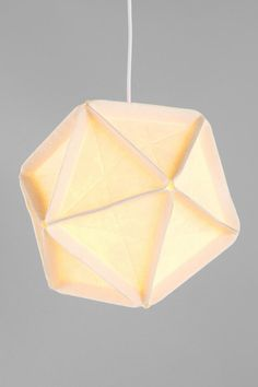 love. own a true vintage hanging lamp quite similar. AREAWARE Icosa Lamp  #UrbanOutfitters
