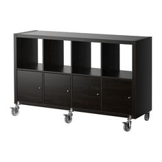 KALLAX Shelf unit on casters with 4 doors - black-brown - IKEA $169- could be toy storage with doors as shown or with drawer units.  Click thru to see options.  Wheels are optional.