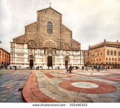 "Bologna, Italy - December 6, 2014: the San Petronio basilica facade  and the ""pavaglione"" flooring of Piazza Maggiore"