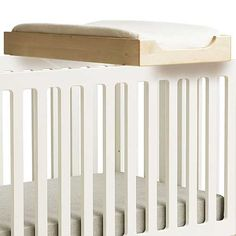 Changing Station in Natural Birch $255.00 This changing station is a practical, space saving asset in the nursery. It attaches securely on top of Oeuf cribs as well as on most other standard size cribs. This changing station not only eliminates the need for a changing table, but also positions your baby for safer and more convenient changing. Includes changing pad. 50 lb. weight limit.