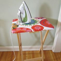 I love ideas like this. Totally practical, completely usable and cute too. This little side table ironing board is perfect for those sewing projects you%u2019ve been meaning to complete. No more lugging out the ironing board folks. Check it out at Just Craft