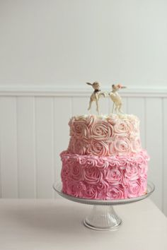 Pink cake with rabbit cake topper