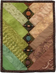 A Fancy Braid mini quilt by Michelle L. Mitchell (Texas). AAQI auction quilt, embellished with beads