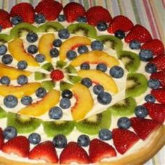 """Fruit Pizza - 1 tube of sugar cookie dough smooth out on a round pizza pan. Bake the dough according the directions on the package, then let cool.   Mix 1 (8 oz.) cream cheese with 2 cups of powdered sugar and spread over the top. Place your favorite fruit sliced  and arranged to make a pretty design.  There are so many ways and it is """"ALWAYS"""" a crowd pleaser ! They will love you  ♥"""