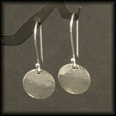 Hammered Silver Earrings / Small Sterling Silver Circle Dangle Earrings / Disk Timeless Design Cute Simple Everyday Wear. $21.00, via Etsy.