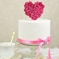 Tutorial on how to add a little extra love to your Valentine's Day and create a pretty ruffled heart cake!