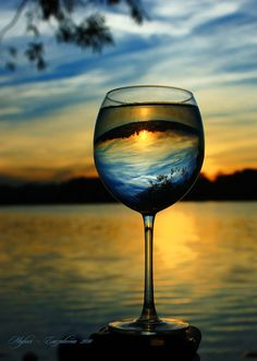 awesome shot of a sunset using a wine glass as a prism.