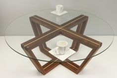CROSS ROADCROSS ROAD Coffe table made from mahogany (sapele) with maple inserts, oiled.  diameter 100 cm.  thickness of glass 8mm.