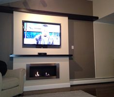 Lata Ventless Fireplace recessed under TV - Kamin Modern Ethanol Fireplace, Fireplace Wall, Fireplaces, Fireplace Heater, Fireplace Design, Wall Tv Stand, Plasma Tv Stands, Tv Mounting Brackets, Tv Bracket