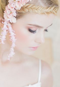 We adore how the shape and movement of the individually joined hyacinth blossoms complement the pattern and movement of the fishtail braid. Peach and blus perfection! {Floral Design: Susan Kelly, Three Sisters Flowers & Events | Photographer: Retrospect Images | Hair and Make Up: A-list Hair and Makeup Artist Kat | Model: Kayla Marie Cromer | Backless Wedding Dress: Saffron by Galia Lahav }
