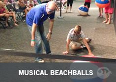 Musical Beachballs - Blindfolded players try to capture a ball when the music stops