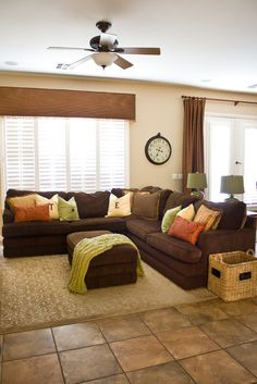 I like the valance and the splash of color on brown sectional