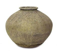A terracotta oil jar of globular form. Estimate £100-200