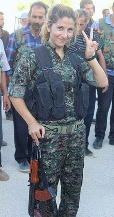 Rehana, a female Kurdish fighter who became a poster girl for the Kobane resistance movement after a picture of her making a peace sign was retweeted thousands of times on Twitter has reportedly been beheaded by ISIS.
