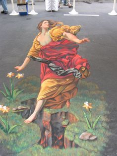 3D Anamorphic Street Painting - Persephone Falling into Hades    Art Along the Rogue Street Painting Festival 2008. This painting is an original concept based on a figure by Guido Reni (1575 - 1642). This illusion chalk painting depicts the moment when Hades opens the ground beneath Persephone's feet to kidnap her and make her his wife.