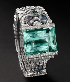 Cartier Boreal Bracelet - Platinum, one aquamarine, four spinels totalling carats, brilliants. PHOTO Julien Claessens & Thomas Deschamps © Cartier by susanna Cartier Jewelry, Antique Jewelry, Jewelry Bracelets, Vintage Jewelry, Diamond Bracelets, Bling Jewelry, Gold Jewellery, Jewlery, Bangles