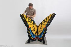 """Artist Sean Kenney created this """"sculpture of an in-flight Tiger Swallowtail butterfly [that] is over 5 feet across and was built with 37, 481 LEGO pieces.""""  Photo credit: Sean Kenney"""