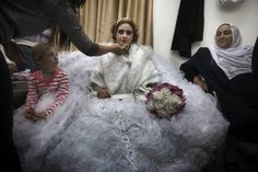 Mayanda Abud, a 27-year-old Syrian Druze bride from Damascus, prepares for her wedding ceremony after she crossed the Syrian-Israeli border pass of Quneitra in the Israeli-occupied Golan Heights on Nov. 3, 2011. Mayanda Abud left her family in Syria and entered the strategic plateau that Israel captured from Syria in the 1967 Six Day War to get married with Munjed Awad (30) who lives in the Israeli controlled area. The passage was facilitated by the International Committee of the Red Cross.