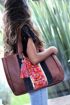 Leather handbag with Guatemalan textile by Lorenza Filati