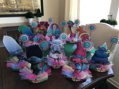 This listing is for (1) Personalized Troll Centerpiece of your choice. Centerpieces are double sided so perfect for placing in the middle of party table. Base is made out of wood. Color of base will vary from various glittery colors. There will be a little hook attached to the base that can be used for attaching balloons as shown in picture with superheroes. Measures about 11 high  Please request a custom order if you would like to purchase 4 or more. Include which troll you would like and…