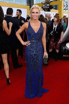 Caroline Boyer looked gorgeous in her beaded navy gown, which matched her beau Luke Bryan, who hosted the event.
