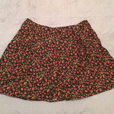 Forever 21 SUPER CUTE floral skirt! LOWERED PRICE! Adorable skirt! Fits like an 16/18. When worn at waist hits mid-thigh. Only worn once, I received many compliments! Just a little loose on me. Forever 21 Skirts Mini