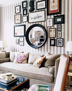 """Great inspiration for my """"gallery"""" wall.  I'm thinking the trick is going to be to include silver, black, AND brown frames plus a mirror or some such... We'll see if I ever get time..."""
