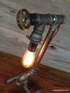 Edison Light  - Plumbing Pipe - Steampunk Art - Industrial Furniture - Faucet Handle. $195.00, via Etsy. or pick this stuff up at the hardware store :D