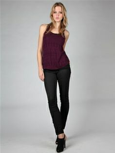 The Misty Razor Back Needle Out Tank by Babakul features a scoop neck and razor back. Patterned loose knit front and solid back. Fitted body.  $50.00
