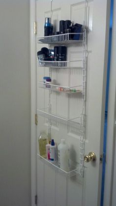 When I moved to my new place it has a extremely small master bath. So I used this rack from my old pantry on the back of the door as extra storage.
