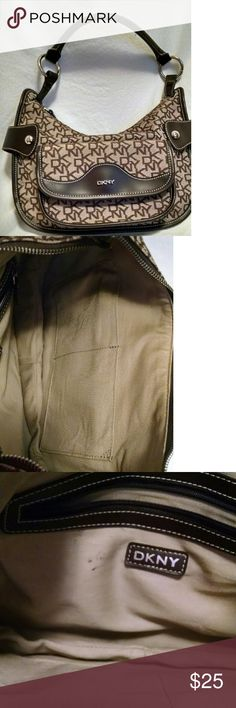 DKNY Shoulder bag EUC! Brown and tan DKNY bag. Three interior pockets, one is zip closure. One exterior snap closure pocket. Some small ink spots as noted in last picture, but will be addressed. Lovely bag! DKNY Bags