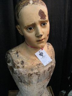 This Colonial-era mannequin is made of a solid piece of wood, has real glass eye