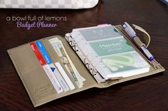 Using a simple planner as a budget organizer complete with cash envelopes.