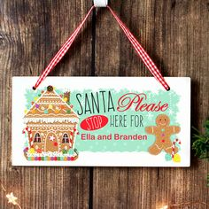 This adorable Gingerbread House Santa Stop Here Wooden Sign is a must have for any child on Santa's nice list! The sign can be personalised with a name up to 20 characters in length. Please note that all text is case sensitive and will appear as e. Christmas Wooden Signs, Classic Christmas Decorations, Perfect Christmas Gifts, Christmas Baubles, Santa Stop Here Sign, Gingerbread House Designs, Gingerbread Man, Santa's Nice List, Personalized Christmas Gifts