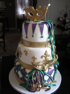 3-tiered Mardi Gras cake w/ buttercream frosting and fondant accents ...