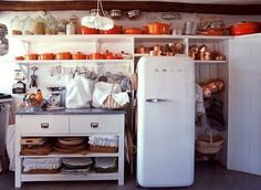 Perhaps it's the open cabinets, the old refrigerator, or the white walls...But, really, let's be honest, it's the Le Creuset collection that makes this kitchen beautiful.