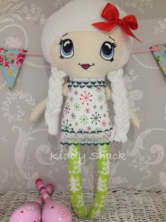 Gorgeous Christmas themed doll with a hand painted face by Kiddy Shack