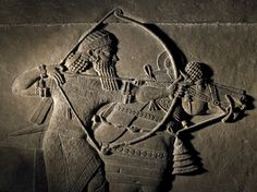 Ashurbanipal drives a spear into one lion's mouth, alabaster wall panel relief, North Palace, Kouyunjik, Nineveh, Iraq, neo-assyrian, 645BC-635BC