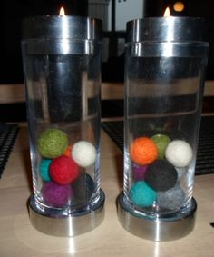 Candlesticks decorated with balls in different colours.