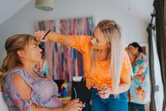 The mother of the bride getting ready. Make up by Charlotte Elizabeth. Photo by Benjamin Stuart Photography #weddingphotography #weddingprep #motherofthebride #makeup #weddinghair
