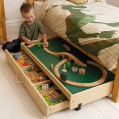 Play table in under-bed storage. and the appliqued dinosaur bed is radical awesome. Bed Storage, Storage Ideas, Table Storage, Playroom Storage, Storage Solutions, Bedroom Storage, Extra Storage, Storage Drawers, Furniture Storage