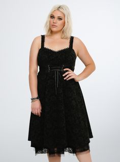 47250ea5cae No more style nightmares  this dress is a dream. A subtle black velvet Jack  Skellington print adorns the swingy dress. While the tulle underlay flares  up ...