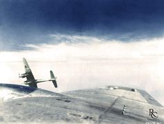 A German Me 410 twin-engine fighter banking right after attacking a B-17G bomber of the US 562nd Bomb Squadron, 388th Bomb Group, over Brüx (present day: Most), Czechoslovakia, 12 May 1944. This...