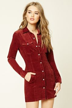 A knit corduroy bodycon dress featuring a basic collar, two button chest pockets, two slit pockets, long sleeves with button cuffs, and a button front.